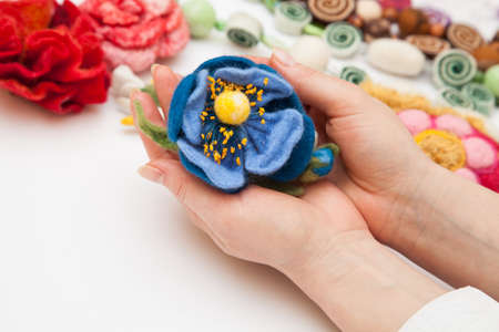 Felting activity - felted flower in womans hands photo