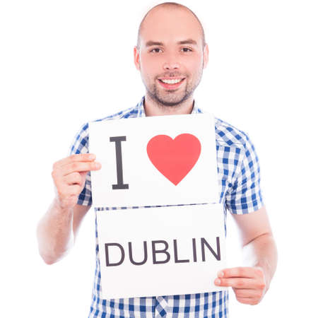 Man with  sign I love Dublin . Series of man with English city signs photo