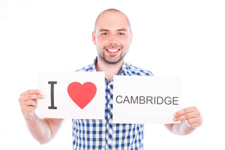 Man with  sign I love Cambridge . Series of man with English city signs photo