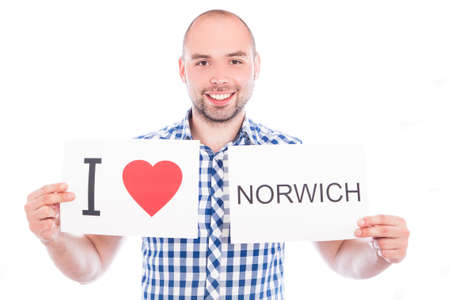 Man with  sign I love Norwich. Series of man with English city signs photo