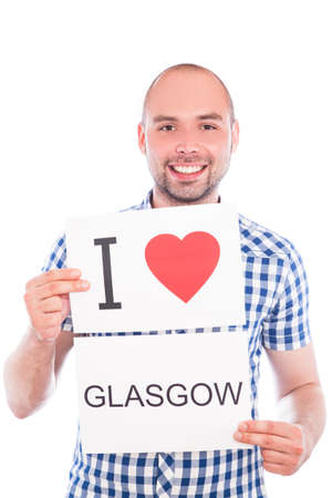 Man with  sign I love Glasgow. Series of man with English city signs photo