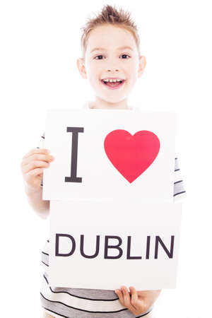 Boy with  sign I love Dublin. Series of boy with English city signs photo