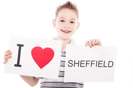 Boy with  sign I love Sheffield  . Series of boy with English city signs photo