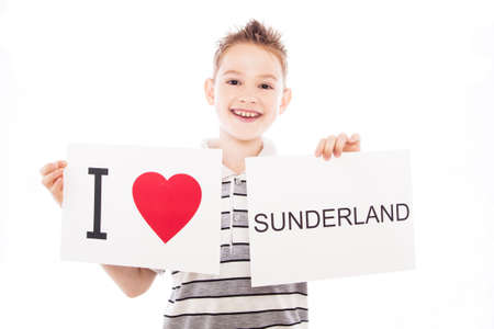 Boy with  sign I love Sunderland. Series of boy with English city signs photo