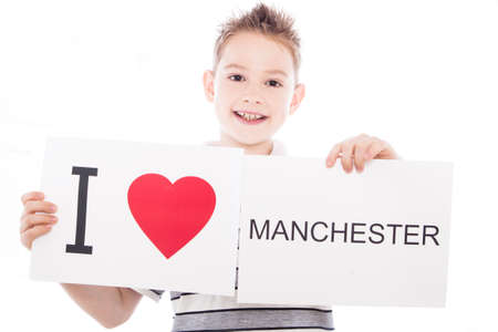 Boy with  sign I love Manchester  . Series of boy with English city signs photo