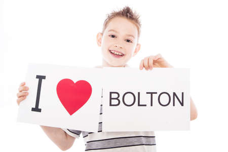 Boy with  sign I love Bolton . Series of boy with English city signs photo