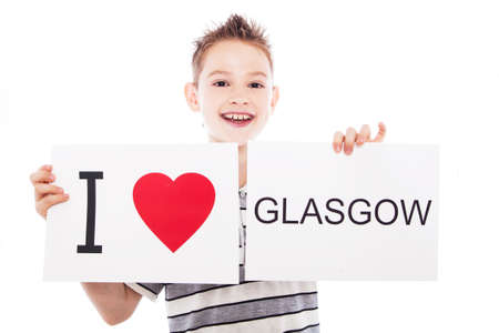Boy with  sign I love Glasgow . Series of boy with English city signs photo