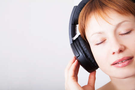 Woman in headphones photo