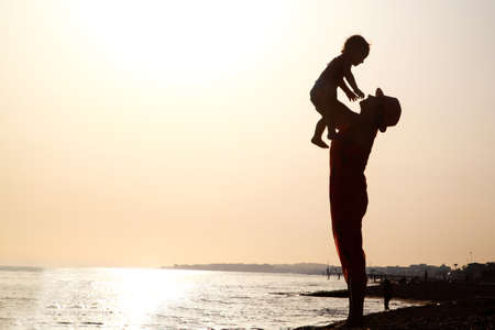 wean: Woman with baby at the sunset Stock Photo