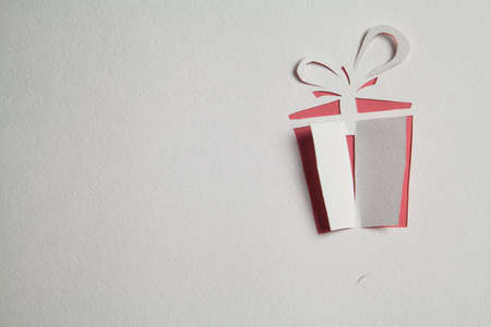 gift paper: Origami gift box cut out from paper Stock Photo