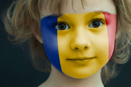 Portrait of a child with a painted Romanian flag Stockfoto