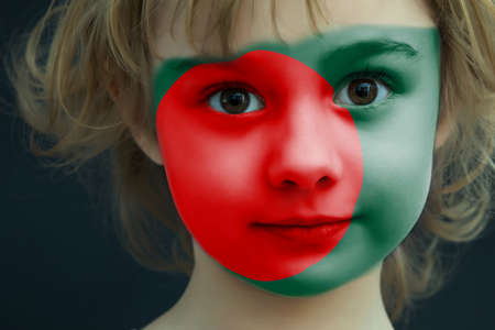 Child with a painted flag of Bangladesh