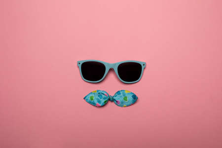 Cool sunglasses on pink background