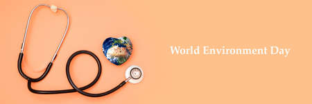 Stethoscope with globe on a red background.Headline