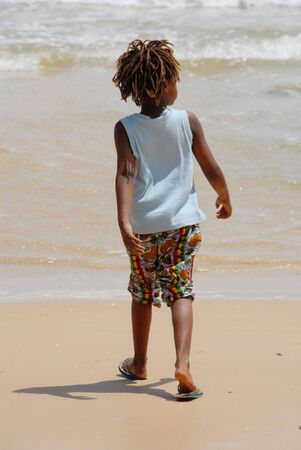 Senegal child walks on the beach Stock Photo - 5021691