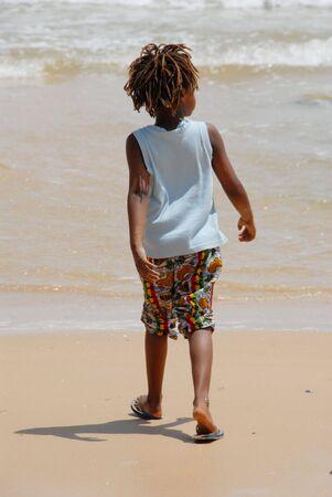 Senegal child walks on the beach Stock Photo - 5021691