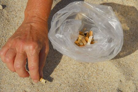 cigarettes on the white beach  photo