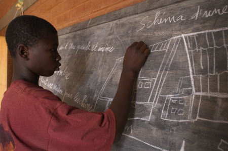 Bobo Dioulasso, Burkina Faso- February 23, 2005:African children at school in the center Recovery Center.  House of detention alternative to prison, which houses children in conflict with the law and prepare them for reintegration into society.