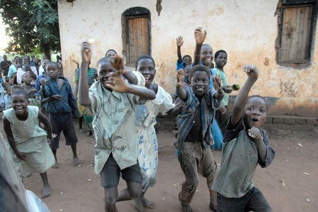 Malawi -May 2, 2007:group of smiling children of a village in Malawi. Malawi is one of the poorest countries on the planet. Stock Photo - 8894217