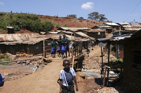 slums: Nairobi, Kenya-January 27, 2004:children living in Kibera.Is the largest slum in Africa in the center of Nairobi.There are no toilets,the sewers are open.There are many orphans, and HIV disease,malaria