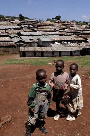 nairobi: Nairobi, Kenya-January 27, 2004:children living in Kibera.Is the largest slum in Africa in the center of Nairobi.There are no toilets,the sewers are open.There are many orphans, and HIV disease,malaria