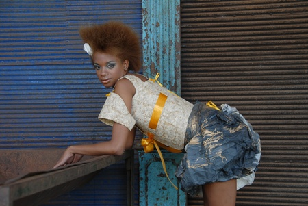 lazarus: La Habana, Cuba-February 11, 2009:Cuban model wears clothes made of paper.The difficulty in obtaining the tissues,has stimulated the designer is the avant-garde Lazarus Dobauchet Rodriguez