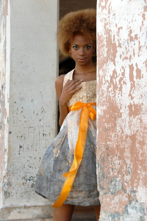 obtaining: La Habana, Cuba-February 11, 2009:Cuban model wears clothes made of paper.The difficulty in obtaining the tissues,has stimulated the designer is the avant-garde Lazarus Dobauchet Rodriguez