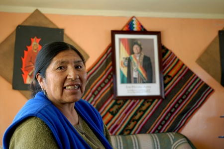 esther: Oruro, Bolivia, June 14, 2006. Esther Morales sister of the President of Bolivia Evo Morales.Esther proudly displays the official photo of her brother Evo as head of government. After the death of their mother Trial as a child ages