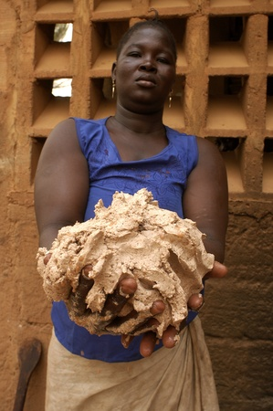 shea butter: Ouagadougou,Burkiana Faso- November 4,2010:African woman producing shea butter handmade.Shea Butter is always used in Africa for food, such as cosmetics and as a drug