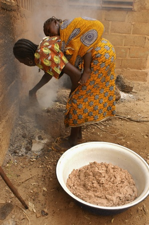 Ouagadougou,Burkiana Faso- November 4,2010:African woman producing shea butter handmade.Shea Butter is always used in Africa for food, such as cosmetics and as a drug