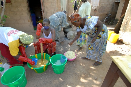 shea butter: Ouagadougou,Burkiana Faso- November 4,2010:African women producing shea butter handmade.Shea Butter is always used in Africa for food, such as cosmetics and as a drug