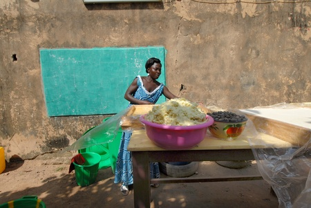 Ouagadougou,Burkiana Faso- November 4,2010:African women producing shea butter handmade.Shea Butter is always used in Africa for food, such as cosmetics and as a drug