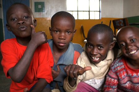 Nairobi,Kenya,March 16, 2008:group of smiling children.Father Kizito Comboni missionary work in Kenya since 1994,founder of the Koinonia community association that brings together the abandoned children of Kenya Stock Photo - 8956204