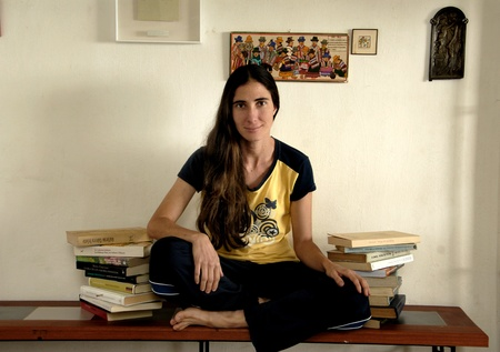 cuba girl: La Habana, Cuba February 6 2009.Yoani Sanchez at his home. She is famous worldwide for his independent blog which regularly publishes stories of Cuban life, characterized by a highly critical tone towards the government