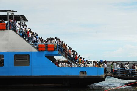 tanzania: Dar es Salaam, Tanzania in February .2010: passengers in the ferry that leaves from the capital Dar Es Salaam to Bagamoyo. Editorial