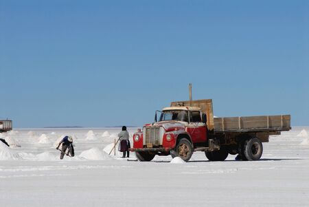 salina: Uyuni,Bolivia May 2009:men who collect the salt in the salt of Uyuni.The Salar de Uyuni salt desert is a huge one of the worlds largest salt works its surface of 11,000 square kilometers