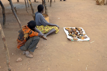 Salima, Malawi in april 2011: african hawkers sell bananas in the street