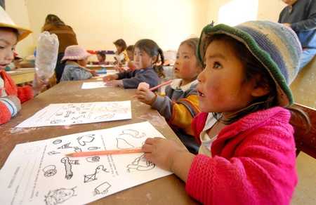 Lima, Peru – August 22, 2007 : Group of Peruvian schoolchildren of elementary draw sitting in the classroom at a school in Lima Stock Photo - 9891348