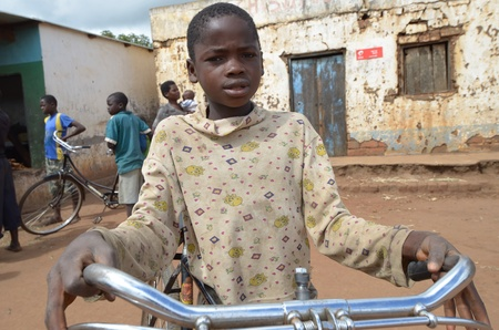 salima, malawi, april 6, 2011: an african girl in the village on his bicycle Stock Photo - 10086225