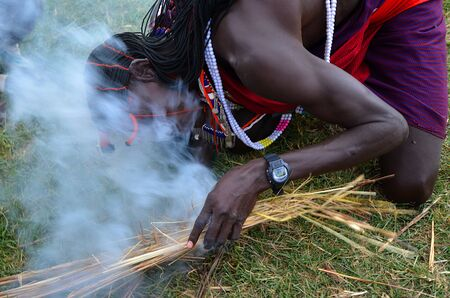 African man Masai man lights a fire   photo
