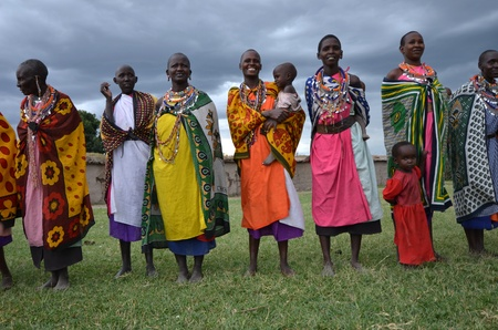 masai: Masai Mara,Kenya, October 17, 2011:Masai women with traditional clothes in a small villages in the Masai Mara