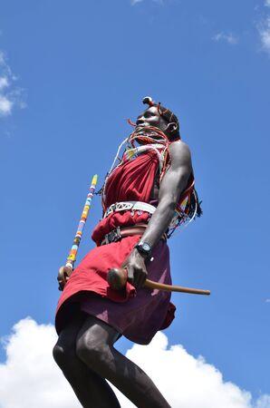 Masai Mara,Kenya-October 19 : A young Masai welcomes tourists with the traditional jumping ceremony.Masai Mara, October 19, 2011