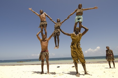 Malindi, Kenya-October 21: A group of young acrobats performs on the beach, October 21, 2011 in Malindi, Kenya  Stock Photo - 11458091