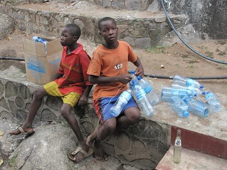 mwanza: Mwanza,Tanzania,March,14,2010 : unidentified street children collects plastic bottles to sell them in Mwanza Tanzania March 14, 2010