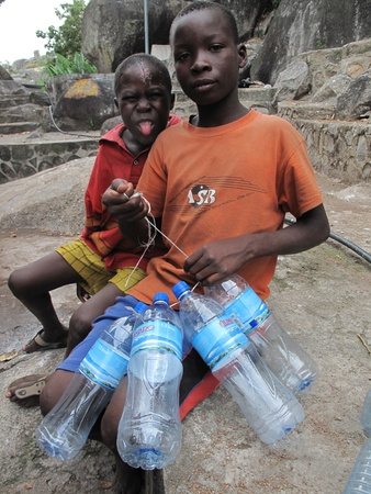 mwanza: Mwanza,Tanzania,March,14,2010 :unidentified street children collects plastic bottles to sell them in Mwanza Tanzania March 14, 2010 Editorial