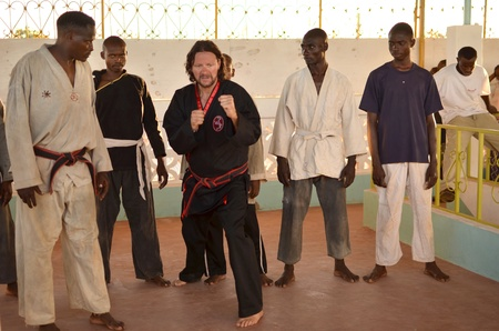 Malindi ,Kenya-October 20,2011:men train in a gym of Vo Vietnam.This gym has been created by an Italian Franco Oriot teacher. The annual registration is of 3 shillings a month