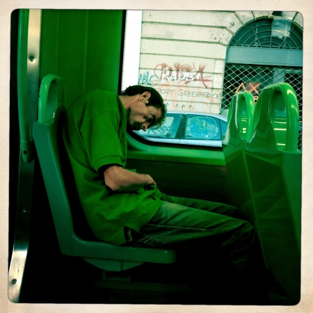 dormant: Milan, Italy,13 September 2012 : poor man in a modern streetcar in Milan. In Italy peoples percentage to risk of poverty is of 25%.
