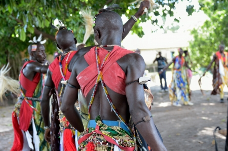 Kartiak, Senegal- September 25,2012: African men dance in the party of initiation. This ceremony is performed every 30 years in the village of Kartiak