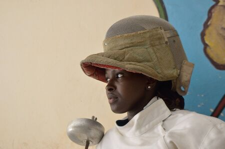 Dakar, Senegal-October 3, 2012: athlete of fencing in the gym, the only school of teachers of weapons. It has the assignment to spread the fencing and to give formation and diffusion in Africa Stock Photo - 16462823
