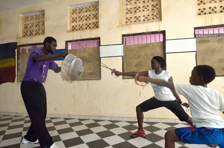 fencing sword: Dakar, Senegal-October 3, 2012: a gym for the fencing, the only school of teachers of weapons. It has the assignment to spread the fencing and to give formation and diffusion in Africa Editorial